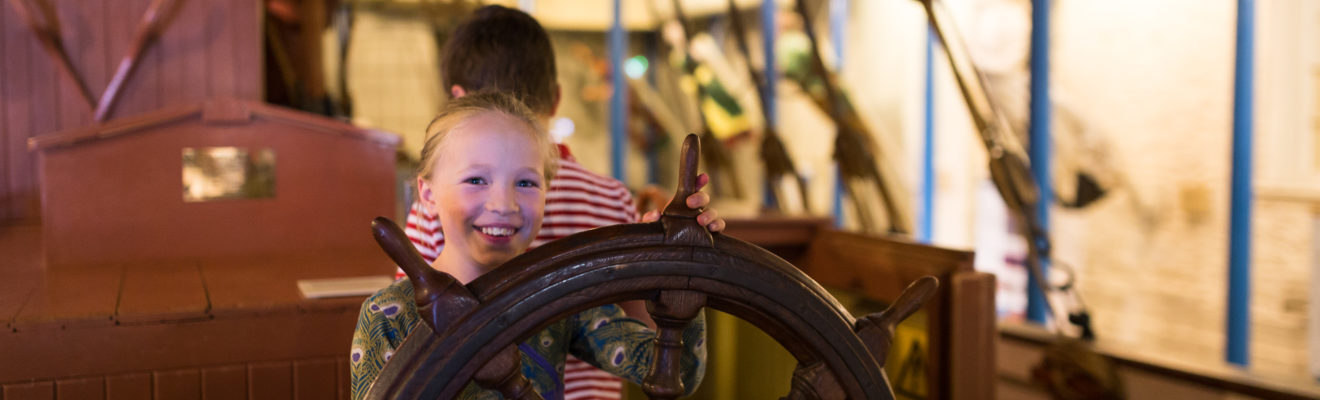 Image: child at ship's wheel