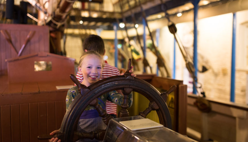 Image: child at ship's wheel